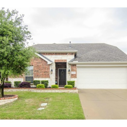 Beautiful move-in ready home with perfectly landscaped curb appe